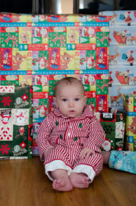 sitting in front of presents picture