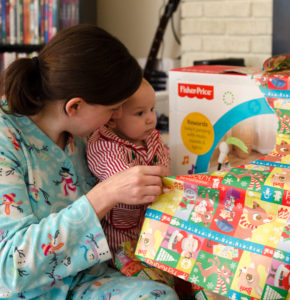 opening presents with mommy picture