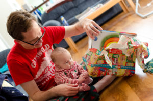 opening presents with daddy picture